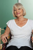 Old woman in a wheelchair Stock Photos