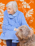 Old woman whit the dog. Old woman stays whit the brown dog Stock Photos