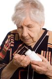 Old woman on white whith tablet Stock Photo