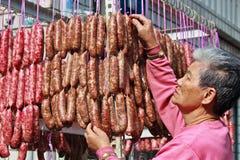 Old woman who Making sausage Royalty Free Stock Image