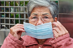 Old woman who wearing mask Royalty Free Stock Images