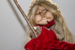 Beautiful Baba Yaga on a broomstick. royalty free stock photography