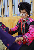 Old Woman With Big Glasses, Red Yao Nationality, Ethnic Minorities In China, Holding A Blue Cloth With Patterns Embroidered By Ha Stock Photos