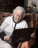 Old woman working on computer Royalty Free Stock Photography
