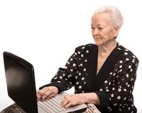 Old woman  working on computer Stock Photo