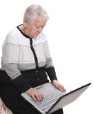 Old woman working on computer Stock Photos