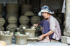 Old woman working on pottery workshop Stock Photos