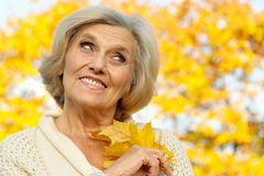 Old woman on a yellow background Stock Photo