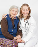 Old woman and the young doctor. Old woman and the sweet young doctor Royalty Free Stock Photo