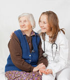 Old woman and the young doctor. Old woman and the sweet young doctor Royalty Free Stock Photography