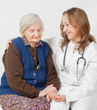 Old woman and the young doctor. Old woman and the sweet young doctor Royalty Free Stock Photos