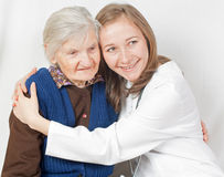 Old woman and the young doctor. Old woman and the sweet young doctor Stock Photo