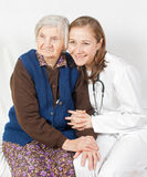 Old woman and young doctor. Old woman and the sweet young doctor Stock Photos