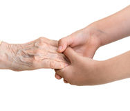 Old woman and young girl  holding hands Stock Photography
