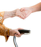 Old woman and young girl holding hands Royalty Free Stock Photography