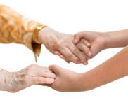 Old woman and young girl holding hands Stock Photos