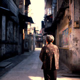Old women. Old  asian women stand in opposite direction  in a narrow alleyway in guangzhou china.longle back Royalty Free Stock Image