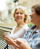 Old women on balcony with coffee Stock Image