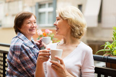 Old women on balcony with tea Royalty Free Stock Photo