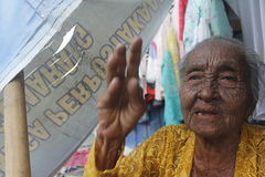 Old women. Daliyem Joyosemito, names old women who saling in a trotoar at Gilingan, Solo, Central of Java Stock Images