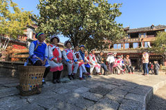 Old women dressed with the traditional attire of their minority in Lijiang Old Town. Lijiang, China - November 10, 2016: Old women dressed with the traditional Stock Photos