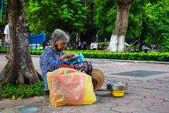 Old women at Hoan Kiem lake, Hanoi, Vietnam. stock images