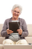 Smiling old women tablet pc Royalty Free Stock Image