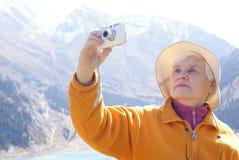 Old women in mountain Stock Photo
