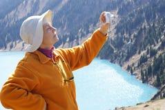 Old women in mountain. Autumn Stock Photography