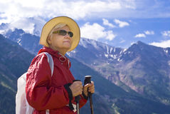 Old women in mountain. Old women with mountains flowers Royalty Free Stock Photography
