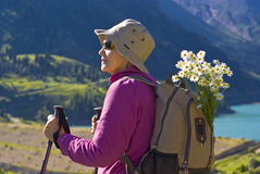Old women in mountain. Old women with mountains flowers Stock Images