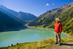 Old women in mountain. Old women with mountains flowers Stock Photos