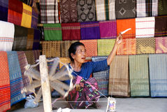 Old women spinning yarn in Lombok, Indonesia Stock Photo