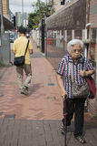 Old women on the street Stock Images
