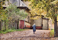 Old women walking along the road Royalty Free Stock Images