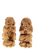 Old wood. Two wooden statues divecchietti on white background stock photography