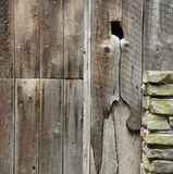 Old Wood. Stone texture on a wooden building royalty free stock images