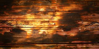 Old wood background. Old wood texture with floral motifs Stock Photography