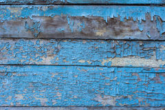 Old wood background with damaged blue paint Royalty Free Stock Image