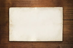 Old wood background and empty paper Royalty Free Stock Images