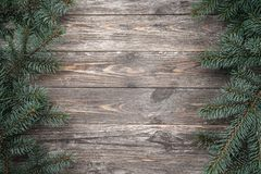 Old wood background with fir branches. Space for a greeting message. Christmas card. Top view.  royalty free stock photos