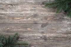 Old wood background with fir branches. Space for a greeting message. Christmas card. Top view.  stock images