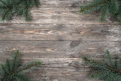 Old wood background with fir branches. Space for a greeting message. Christmas card. Top view.  royalty free stock image