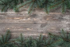 Old wood background with fir branches. Space for a greeting message. Christmas card. Top view.  royalty free stock photo