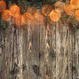 Old wood background with fir branches. Space for a greeting message. Christmas card. Top view. Congratulation card. With light effect stock photo