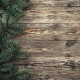 Old wood background with fir branches. Space for a greeting message. Christmas card. Top view. Xmas Square card.  royalty free stock images