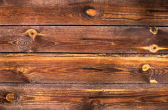 Old wood background. Old background of natural tinted wood planks Stock Image