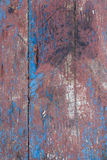 Old wood background. Red and blue painting stock image