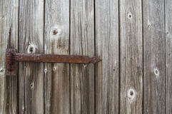 Old wood Background. Old wooden door. Rusty hinge Stock Images