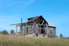 Old Wood Barn Falling Down. An old dilaptiated wood barn in the process of falling down from neglect Royalty Free Stock Images